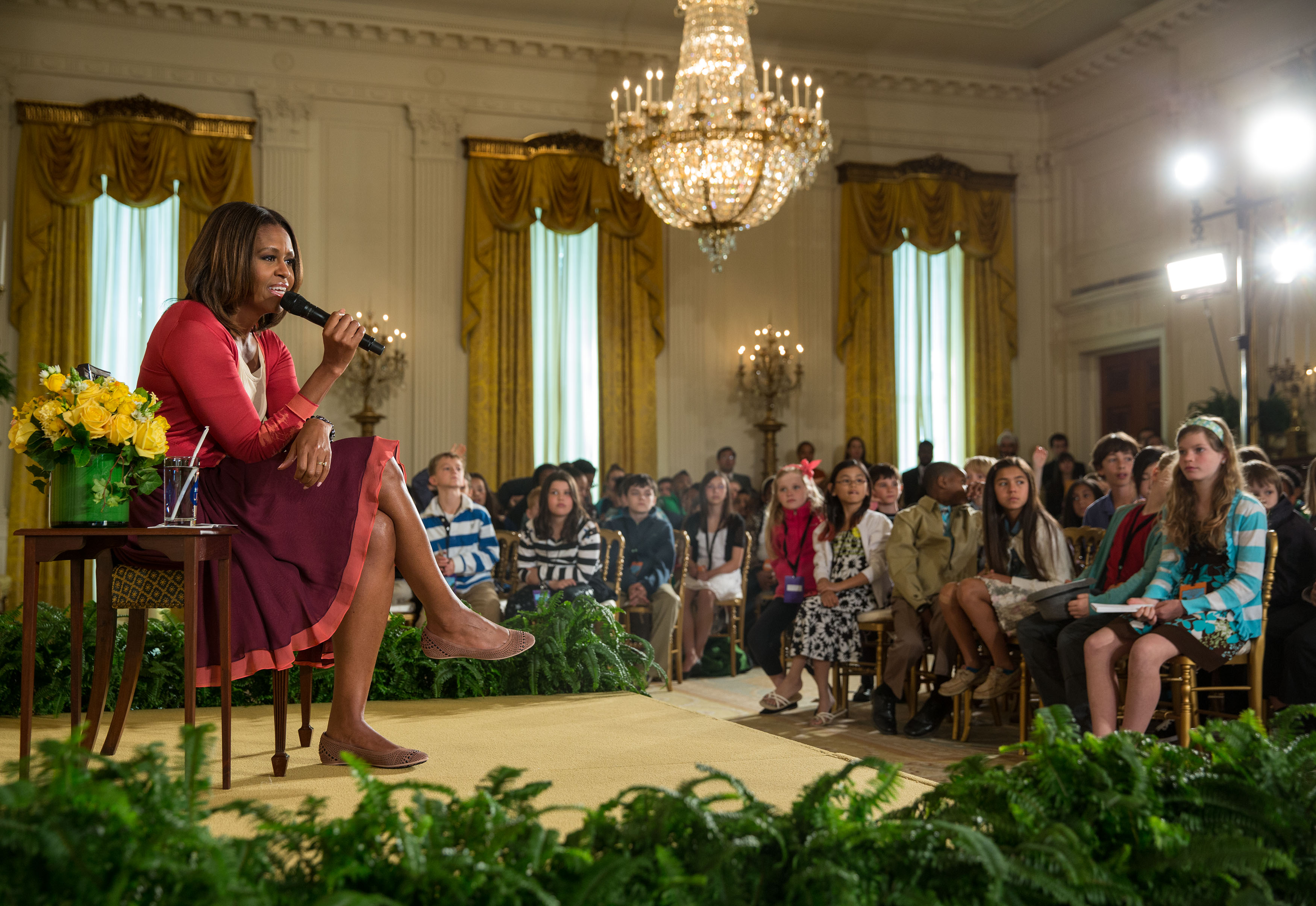 First Lady Michelle Obama answers questions from children at the White House's annual Take Our Daughters and Sons to Work Day