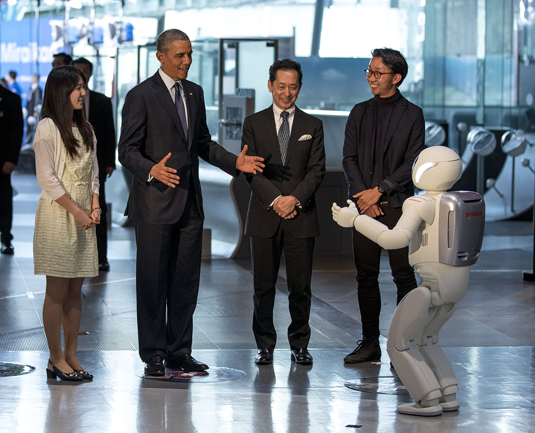 President Barack Obama takes interacts with a robot during a tout at the National Museum of Emerging Science and Innovation (Miraikan), in Tokyo, Japan