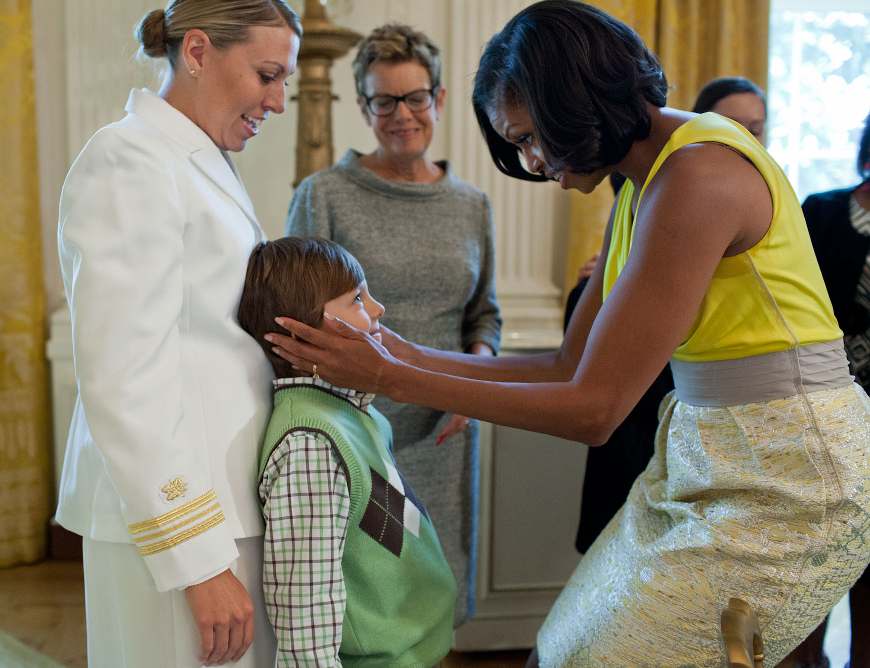 First Lady Michelle Obama Greets Guests During A Mother's Day Tea