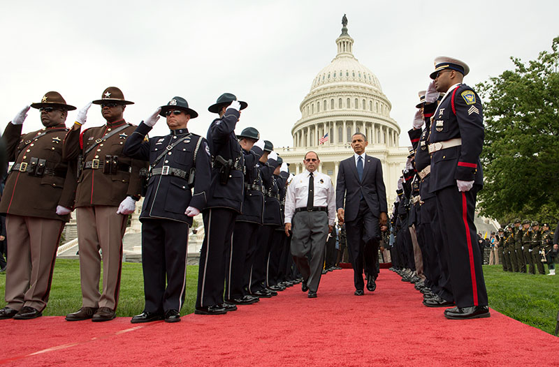 President Barack Obama and Chuck Canterbury, National President, Fraternal Order of Police (FOP) walk through a police honor guard cordon