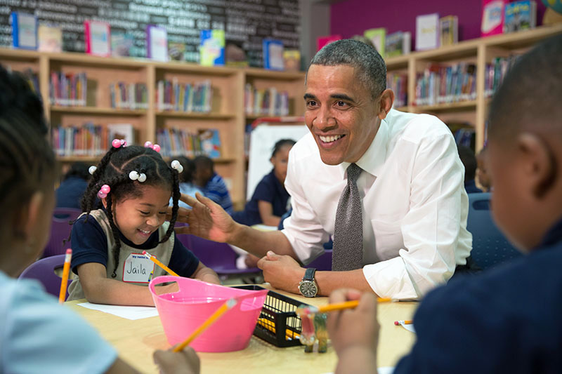 President Barack Obama participates in a literacy lesson with children while visiting a pre-kindergarten classroom