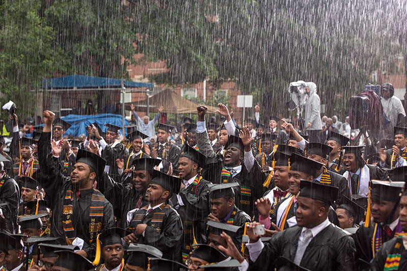 Graduates react as President Barack Obama delivers remarks during the commencement ceremony at Morehouse College