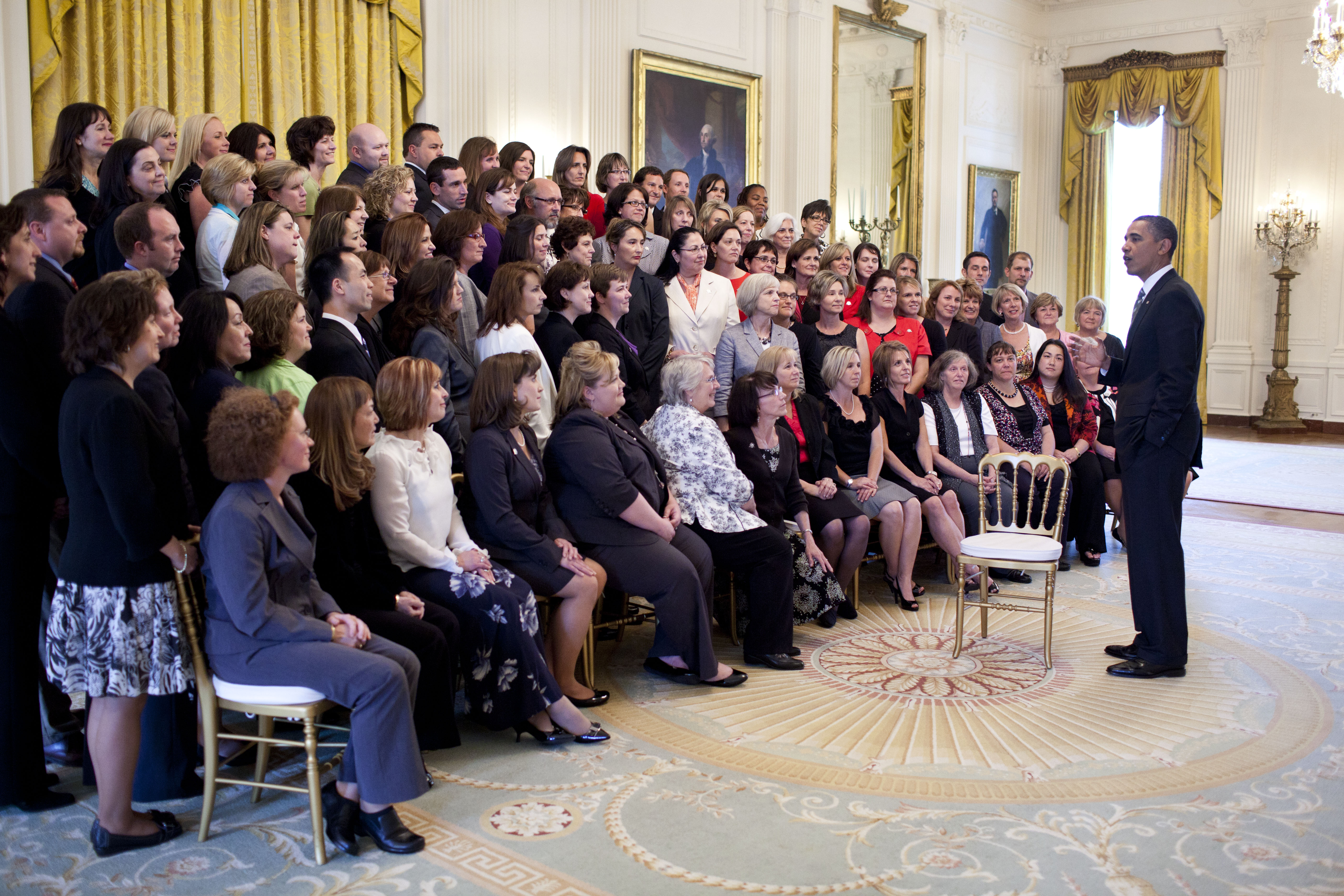 President Barack Obama greets teachers in the East Room of the White House