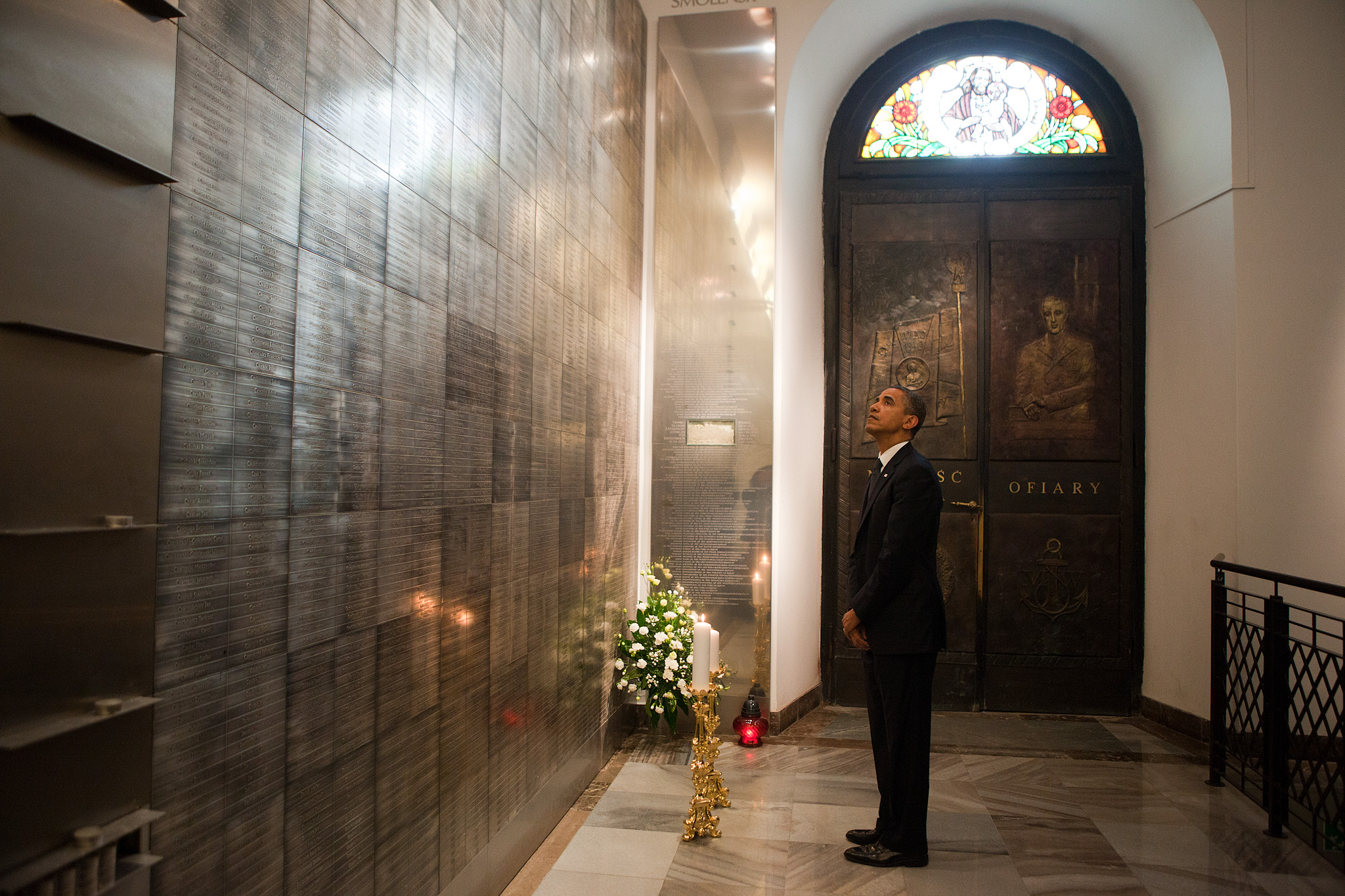President Barack Obama pays his respects while visiting the memorial to the victims of the Smolensk
