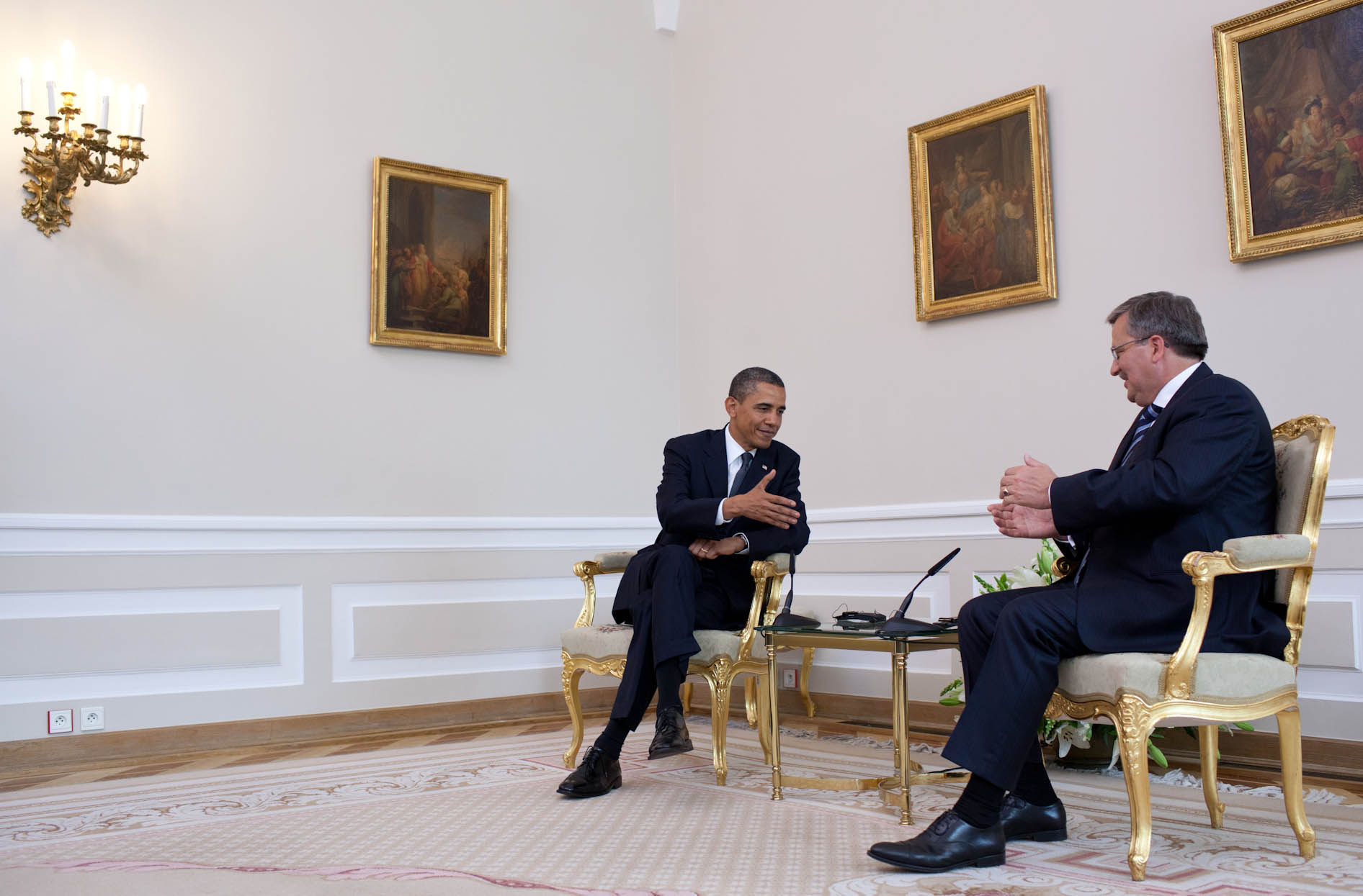 President Barack Obama reaches to shake hands with President Bonislaw Komorowski