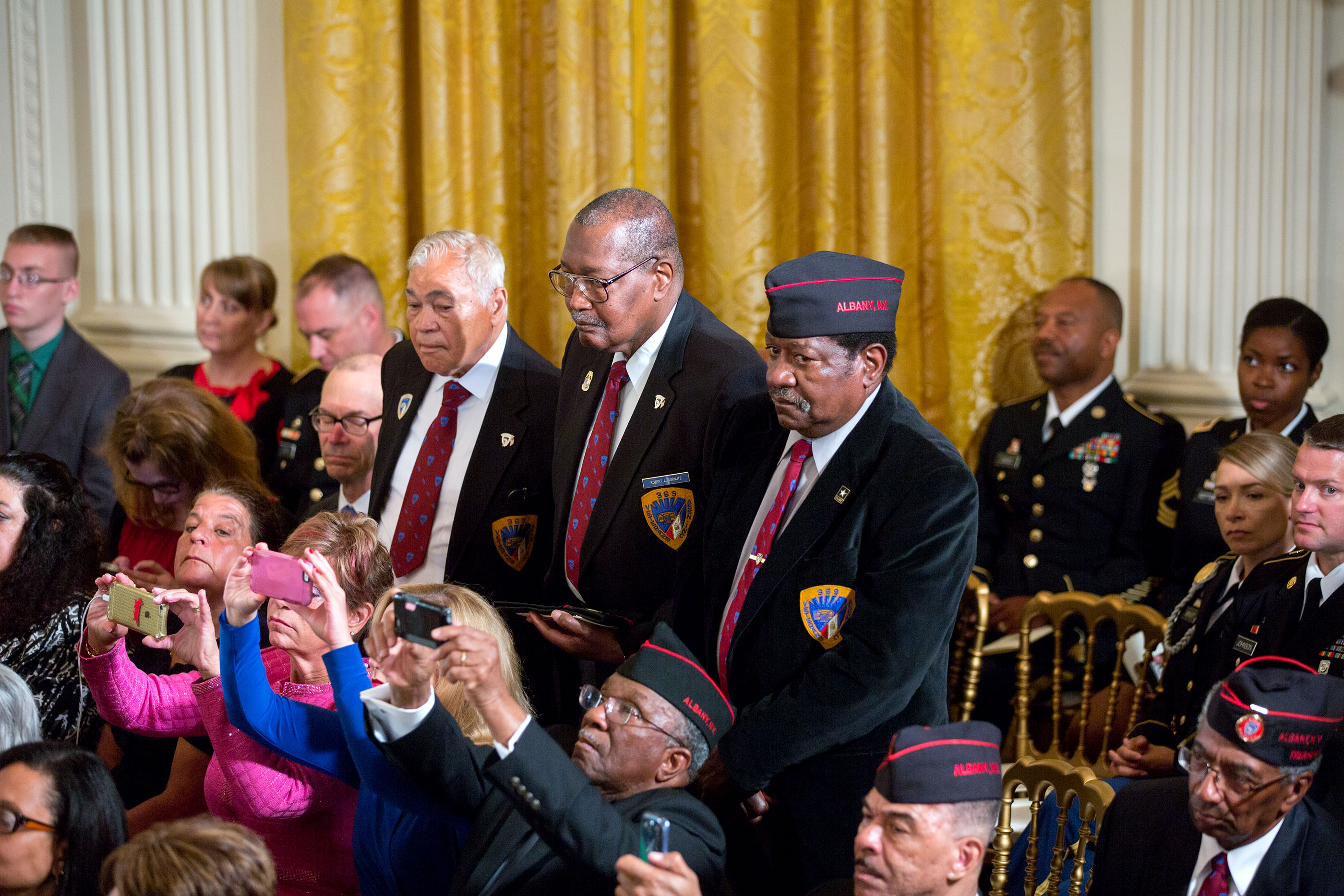 Members of the 369th Infantry Regiment Veterans Association stand as President Barack Obama awards the Medal of Honor posthumously to Army Private Henry Johnson for conspicuous gallantry during World War I, at a ceremony in the East Room of the White Hous