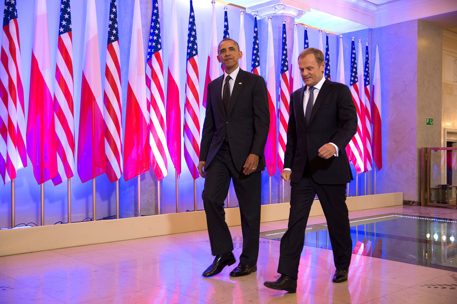 President Barack Obama and Prime Minister Donald Tusk of Poland walk to a bilateral meeting