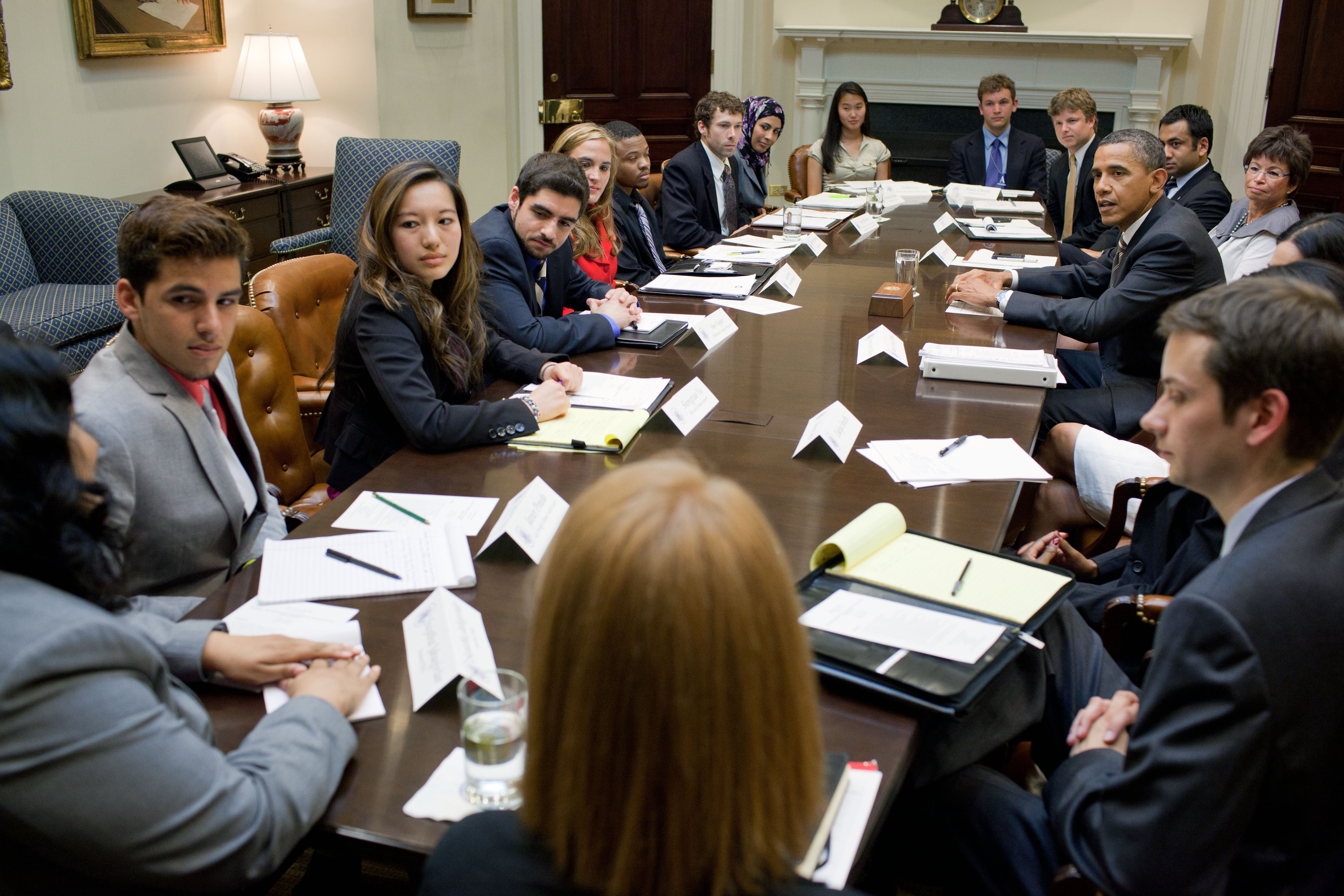President Barack Obama drops by a meeting with young leaders