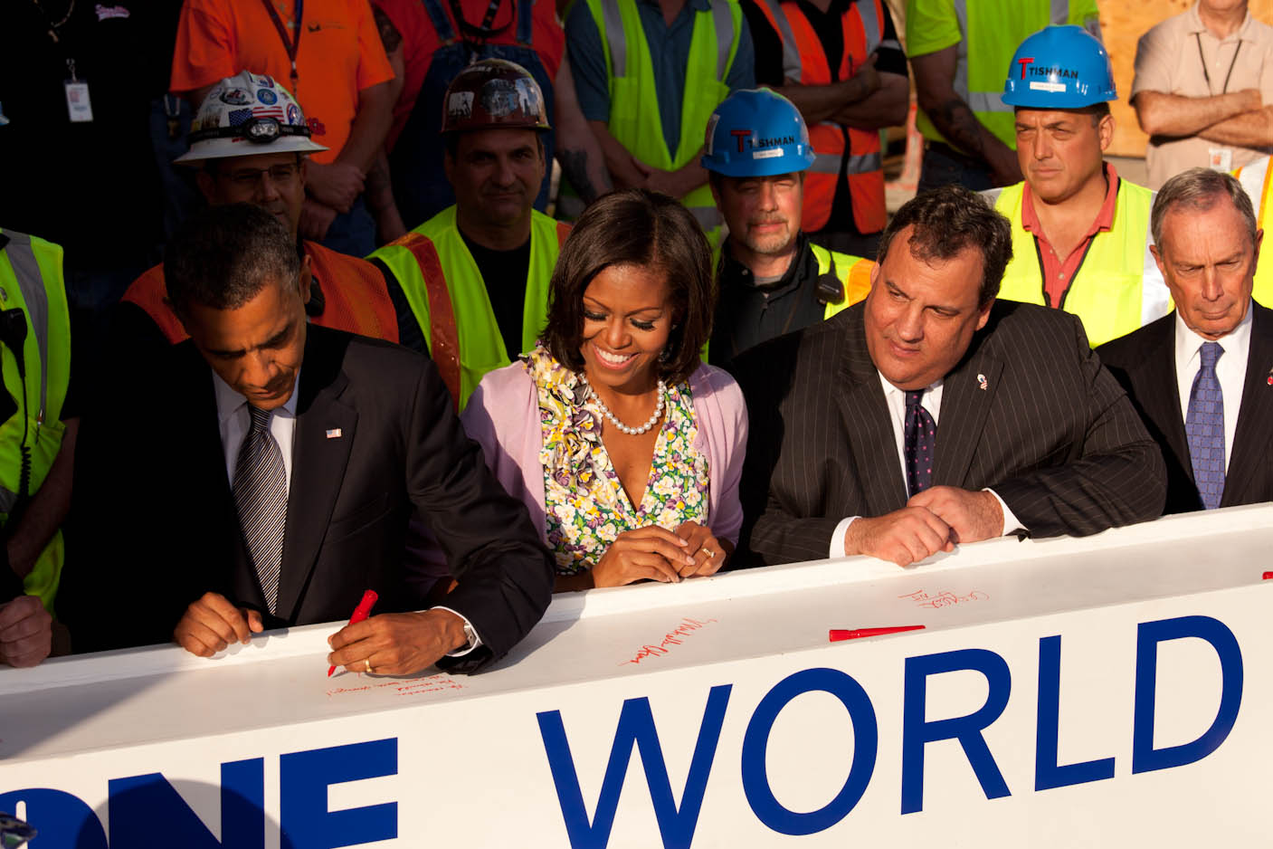 President Barack Obama signs a steel beam at the One World Trade Center site