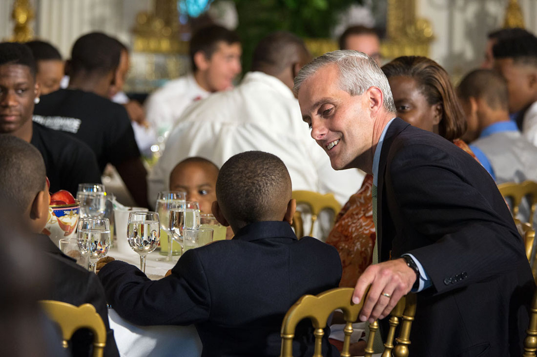 Chief of Staff Denis McDonough talks with a young participant during the Father's Day luncheon