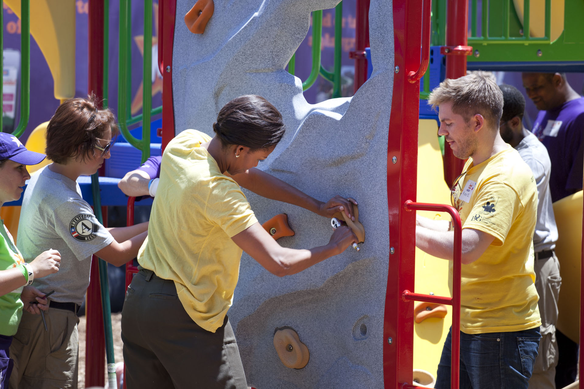 First Lady Michelle Obama Joins Volunteers to Help Build a Playground