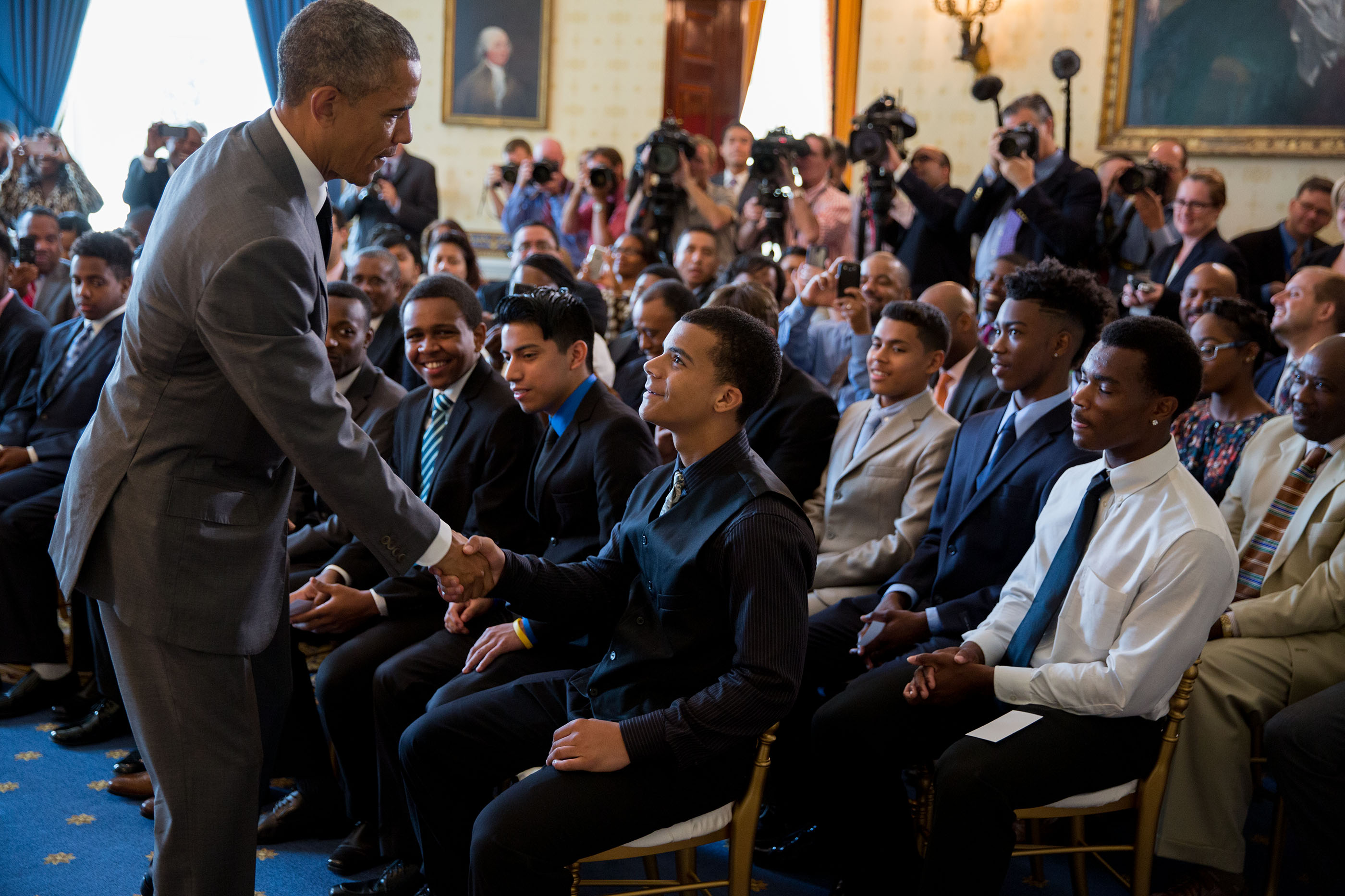 President Obama congratulates mentees following his remarks at the Mentorship and Leadership graduation ceremony
