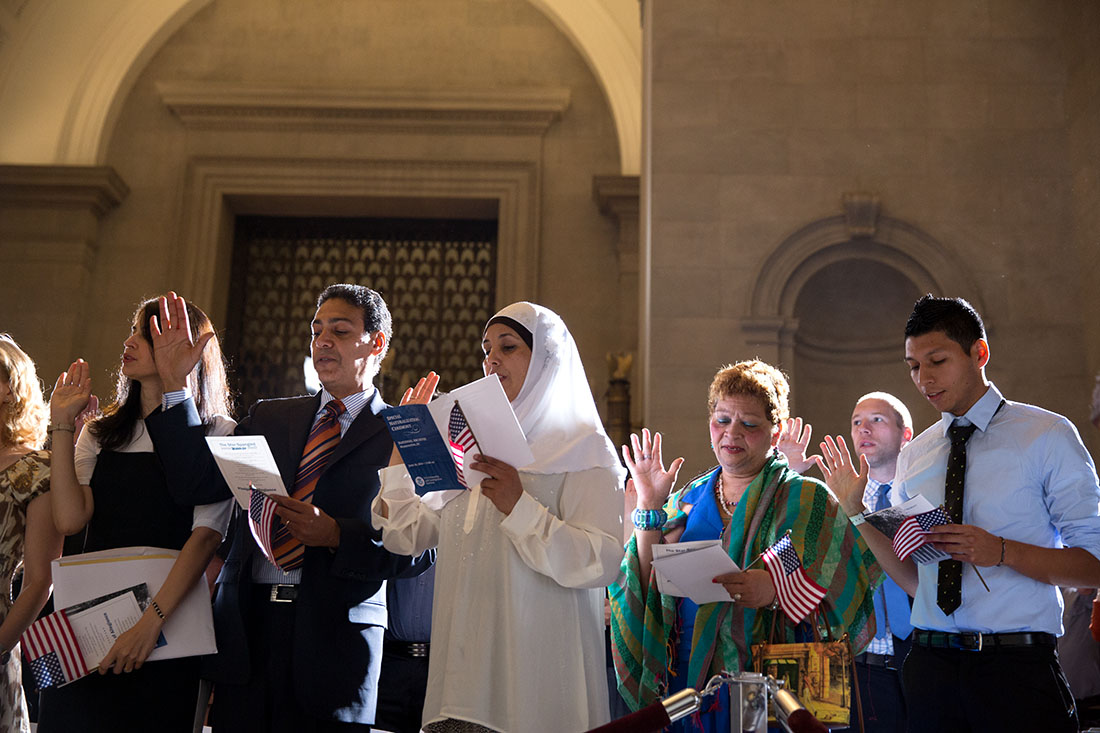 Petitioners are sworn in as new citizens at a naturalization ceremony at the National Archives, June 18, 2014