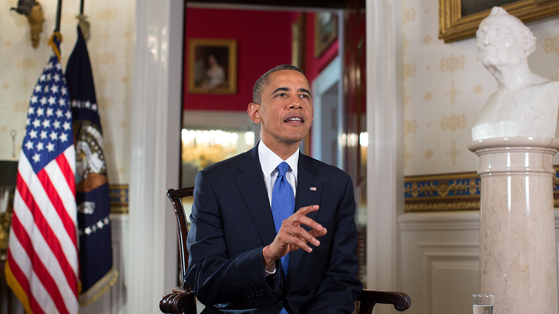 President Barack Obama tapes the Weekly Address and videos in the Blue Room of the White House