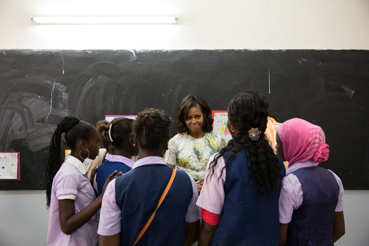 The First Lady talks with students