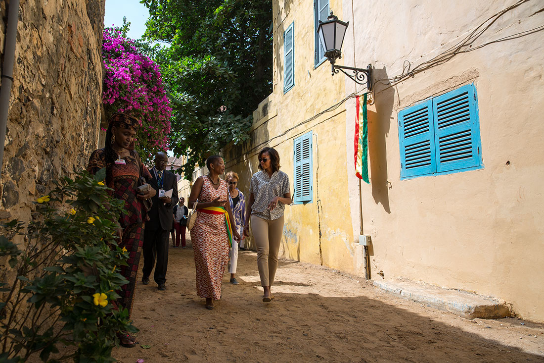 First Lady Michelle Obama walks from the Maison des Esclaves Museum