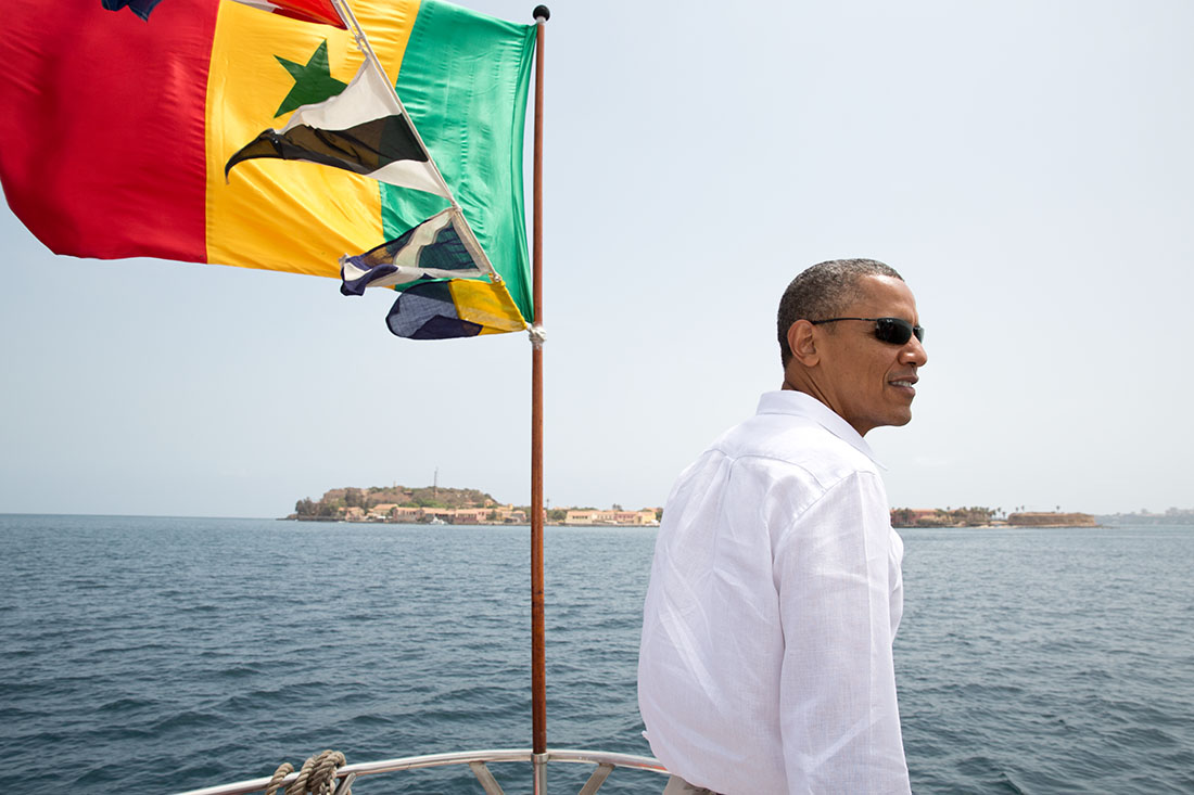 President Barack Obama stands on the bow of the ferry to Gorée Island