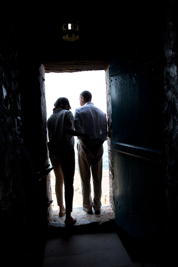 President Barack Obama and First Lady Michelle Obama stand in the 'Door of No Return'
