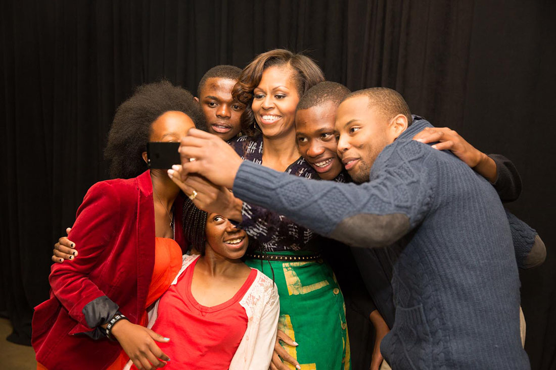 First Lady Michelle Obama and stage participants take a group photo