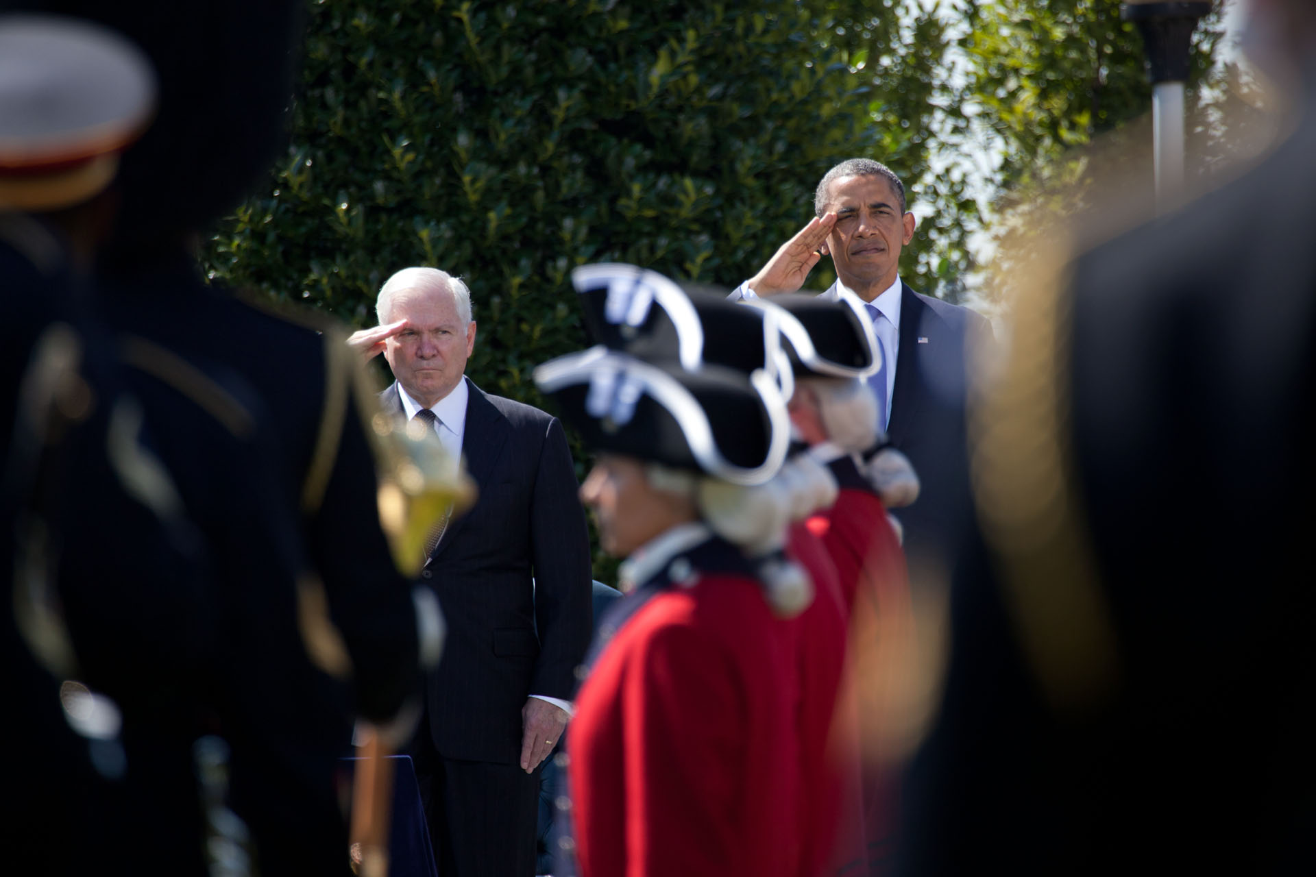 Secretary of Defense Robert M. Gates and President Barack Obama salute as the U.S. Army Old Guard Fife and Drum Corps