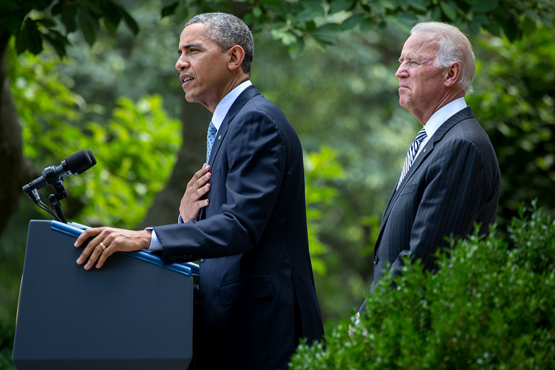 President Barack Obama, with Vice President Joe Biden, delivers remarks on immigration reform in the Rose Garden of the White House, June 30, 2014