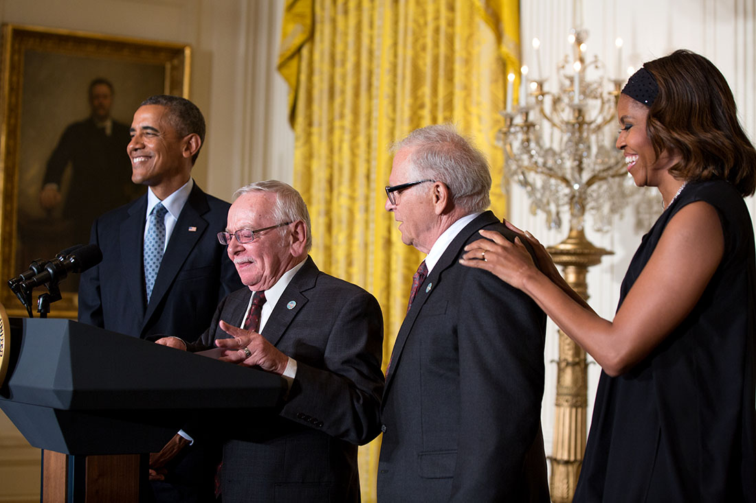 Jim Darby and Patrick Bova introduce President Barack Obama, with First Lady Michelle Obama, during the LGBT Pride Month reception in the East Room of the White House, June 30, 2014.
