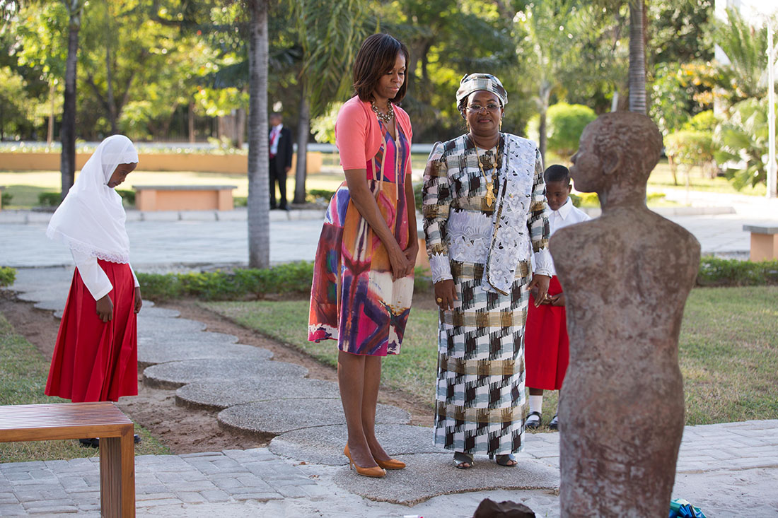 First Lady Michelle Obama and Salma Kikwete pause for a moment of silence