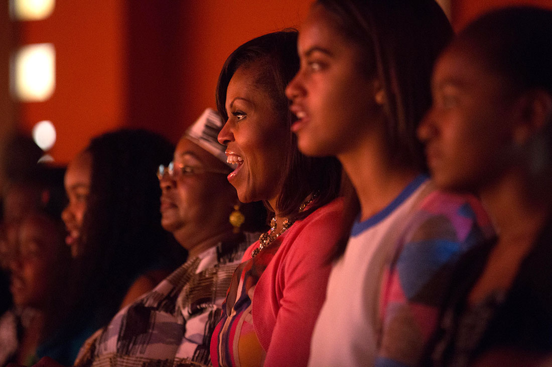 First Lady Michelle Obama and Salma Kikwete, along with daughters Malia and Sasha, watch the Baba Watoto performance