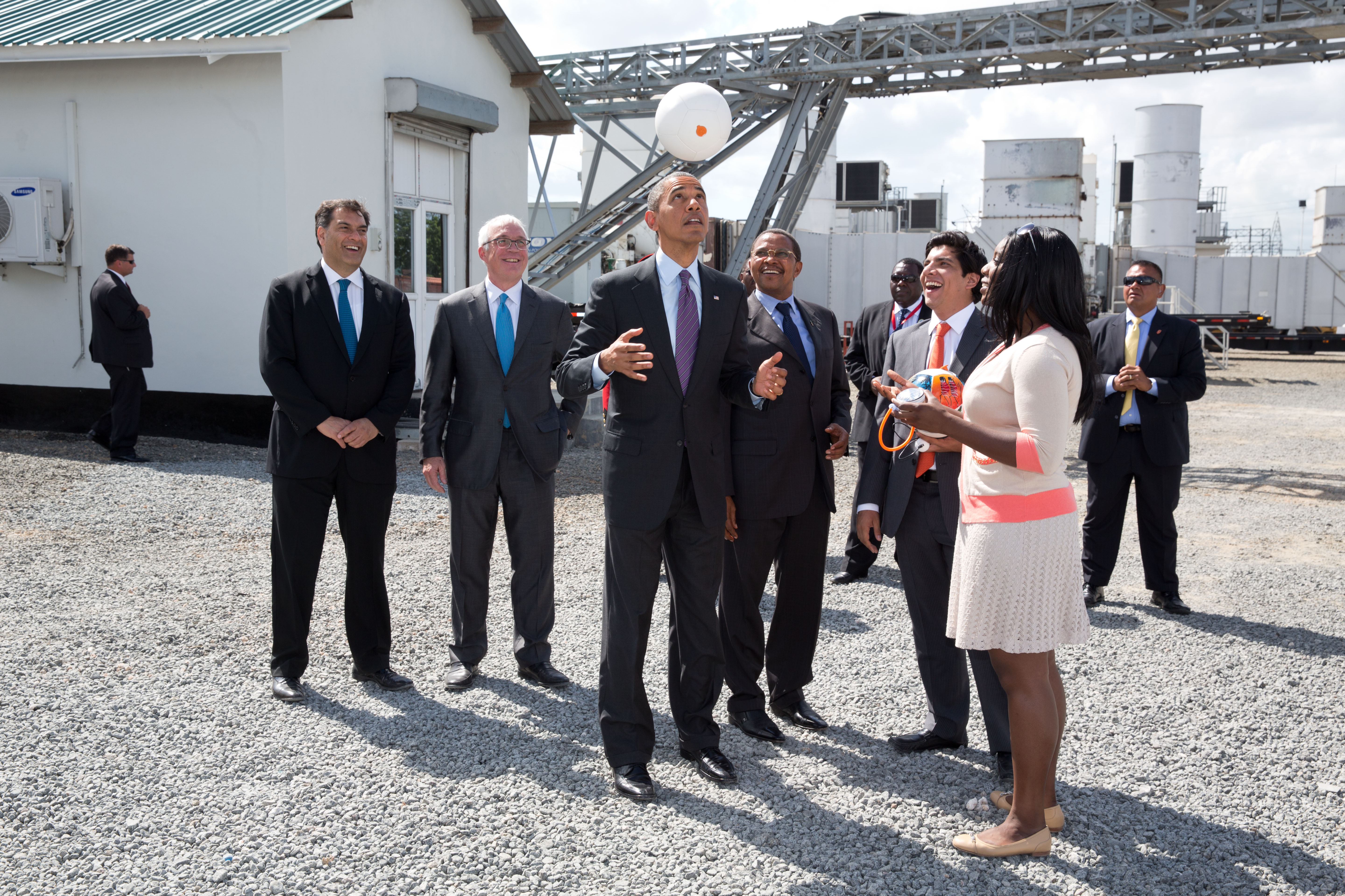 President Barack Obama tosses a Soccket ball in the air at the Ubongo Power Plant in Dar es Salaam
