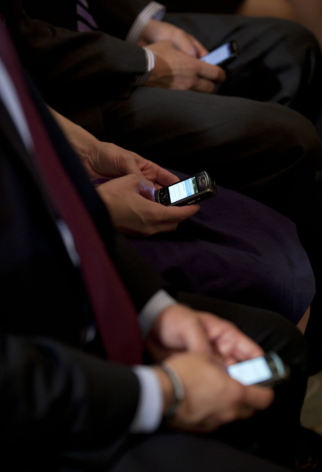 Members of the audience compose Tweets during President Barack Obama's Twitter Town Hall