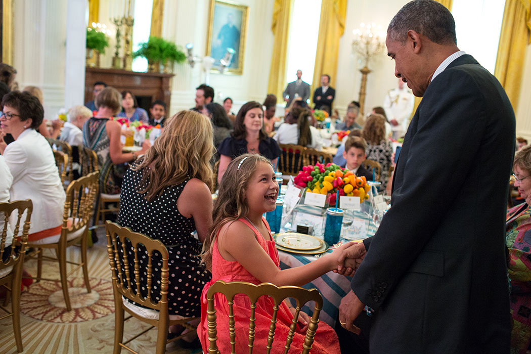 President Barack Obama greets guests at the Kids' State Dinner 2013