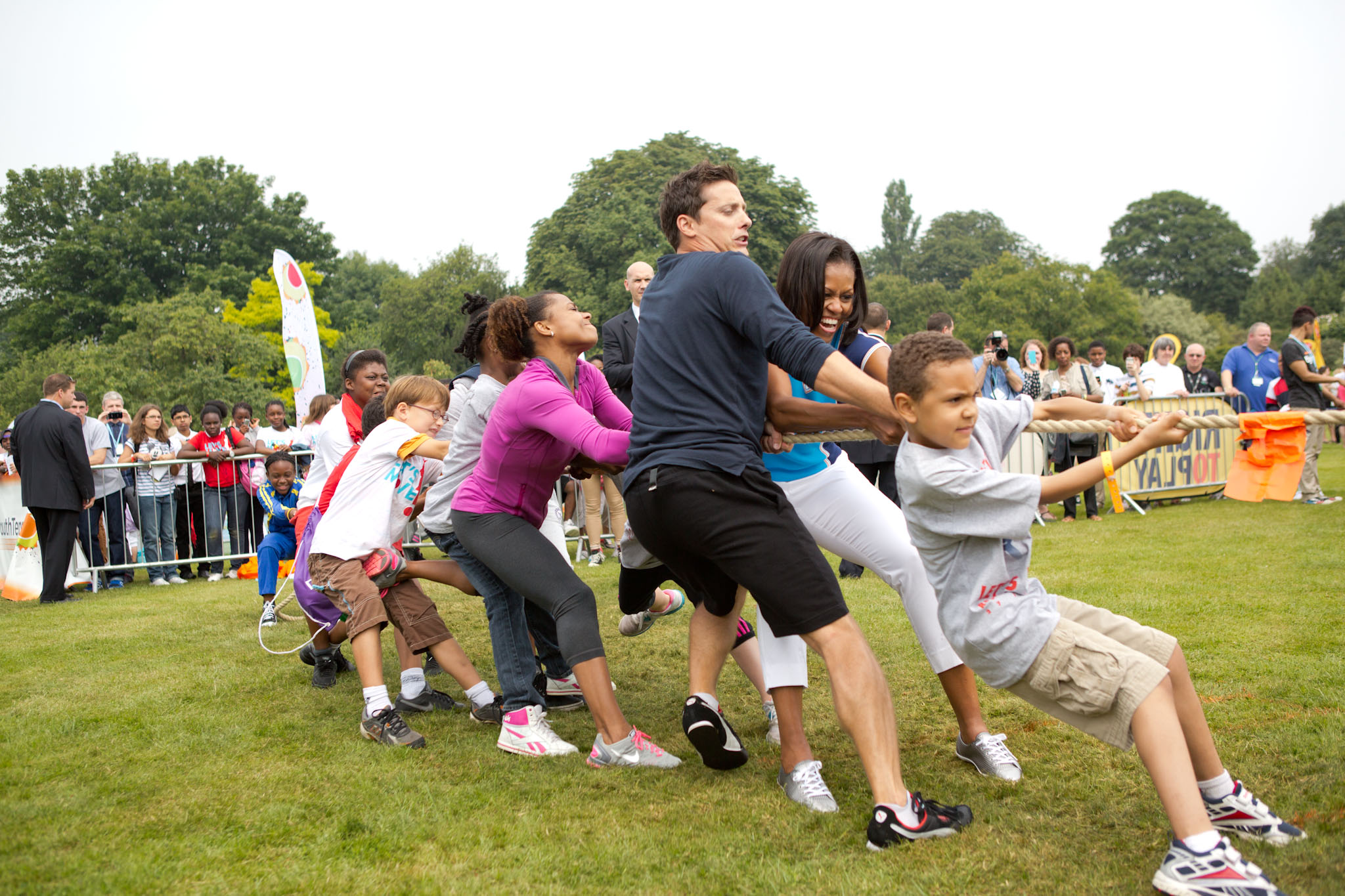 Mrs. Obama Participates In A Tug Of War
