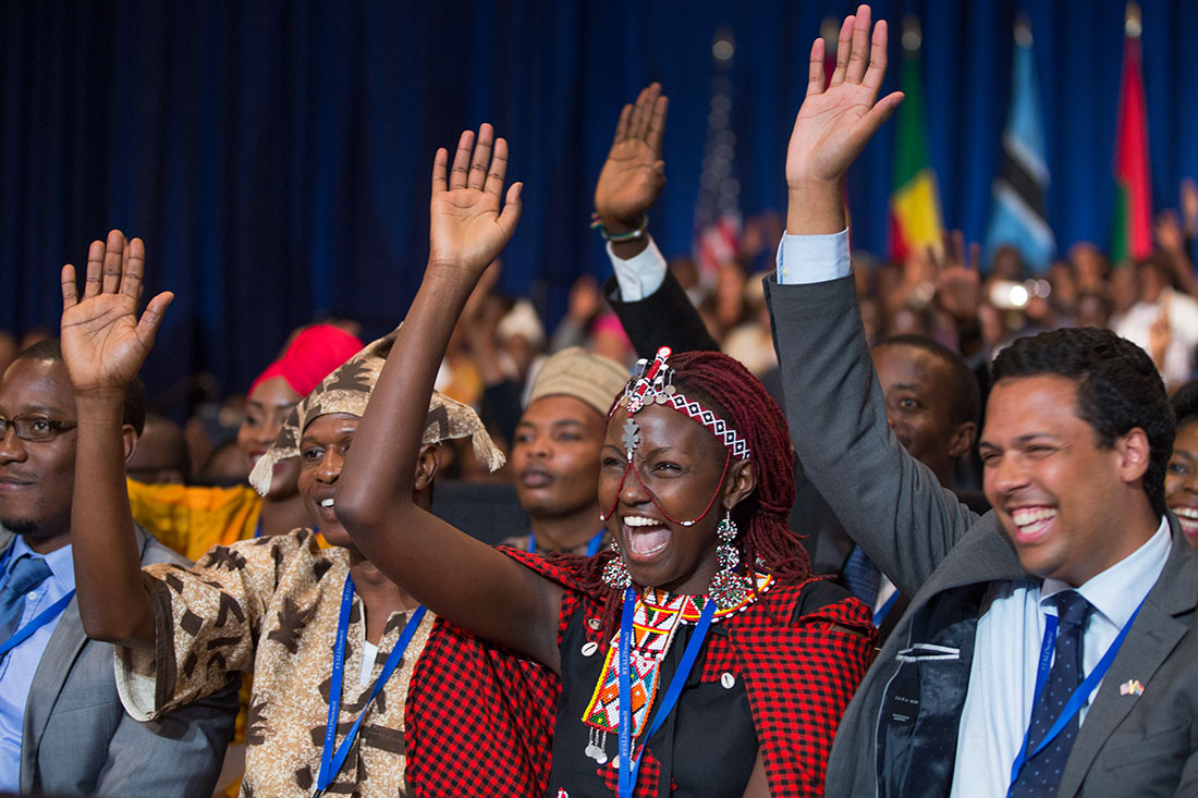 People taking part in the Young African Leaders Initiative town hall raise their hands