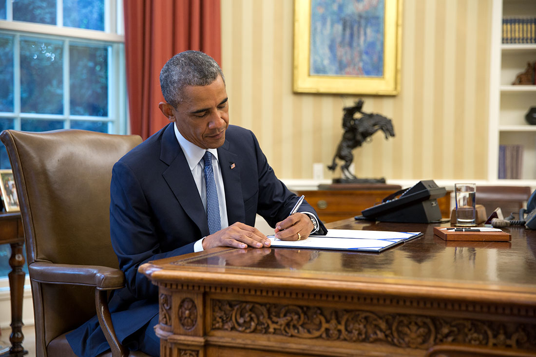 President Barack Obama signs S. 517, Unlocking Consumer Choice and Wireless Competition Act