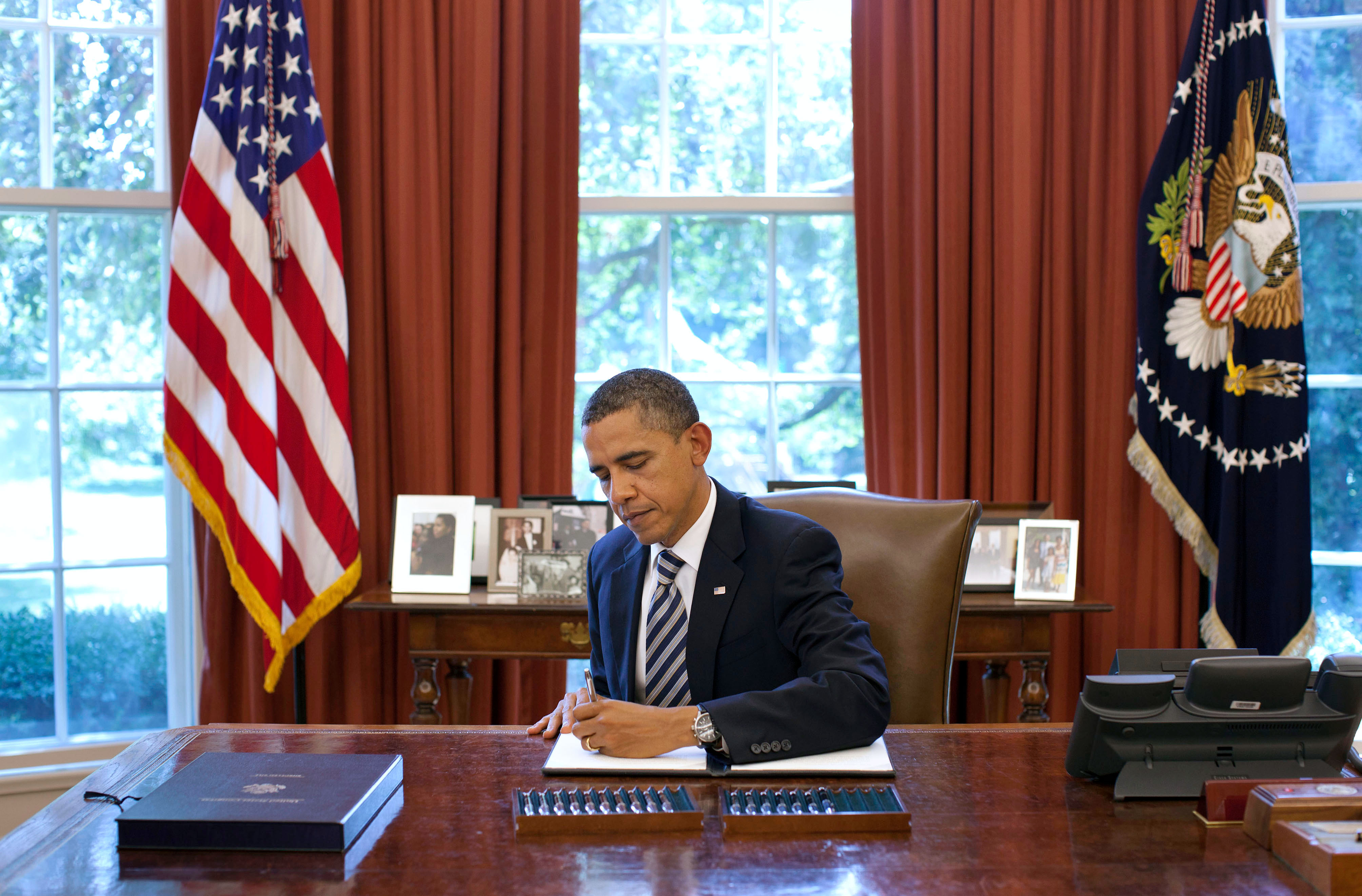 President Barack Obama Signs The Budget Control Act Of 2011
