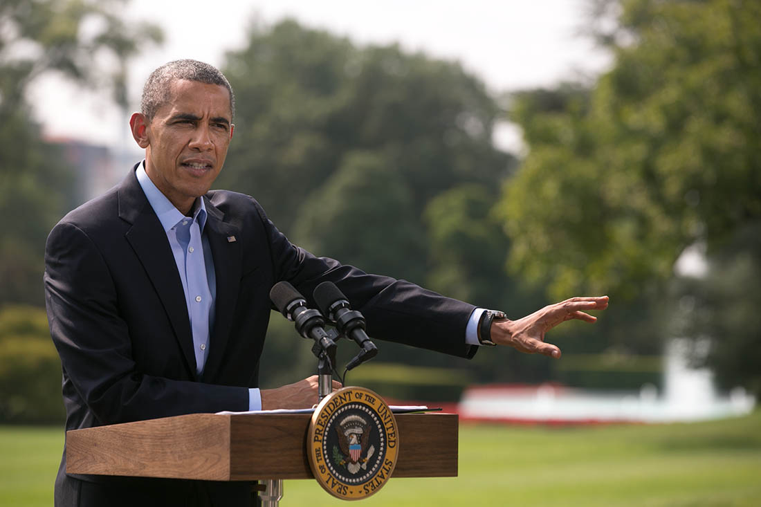 President Obama delivers a statement to the press on the South Lawn before he departs for Martha's Vineyard
