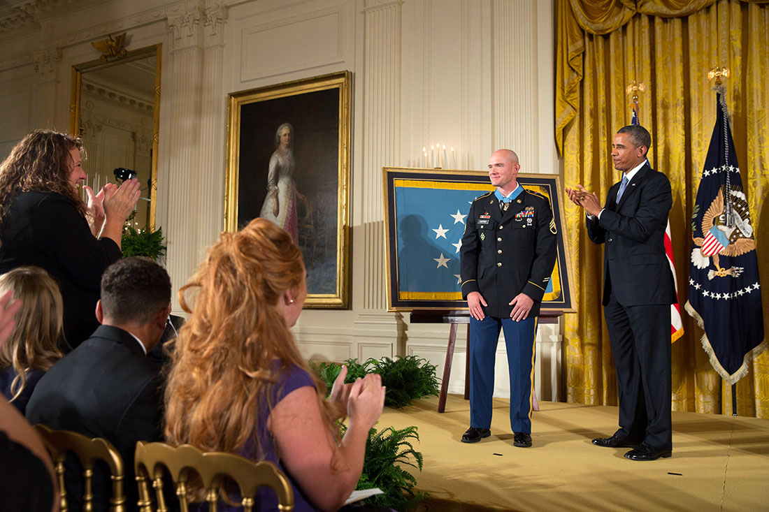 President Barack Obama applauds Staff Sergeant Ty M. Carter, U.S. Army, after presenting him with the Medal of Honor