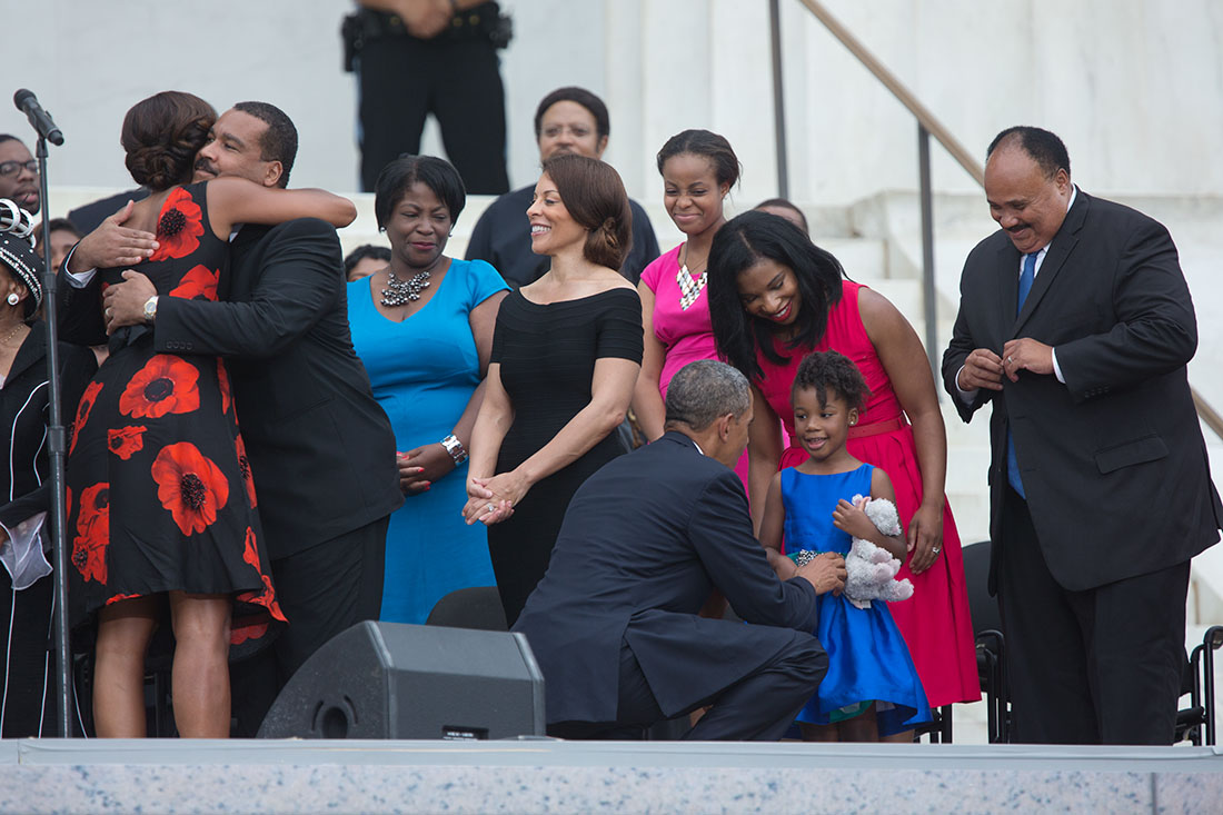 President Barack Obama and First Lady Michelle Obama greet members of the King family