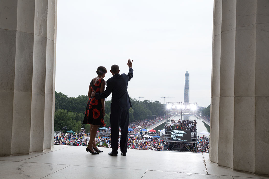 President Barack Obama and First Lady Michelle Obama wave to the crowd at the end of the Let Freedom Ring ceremony