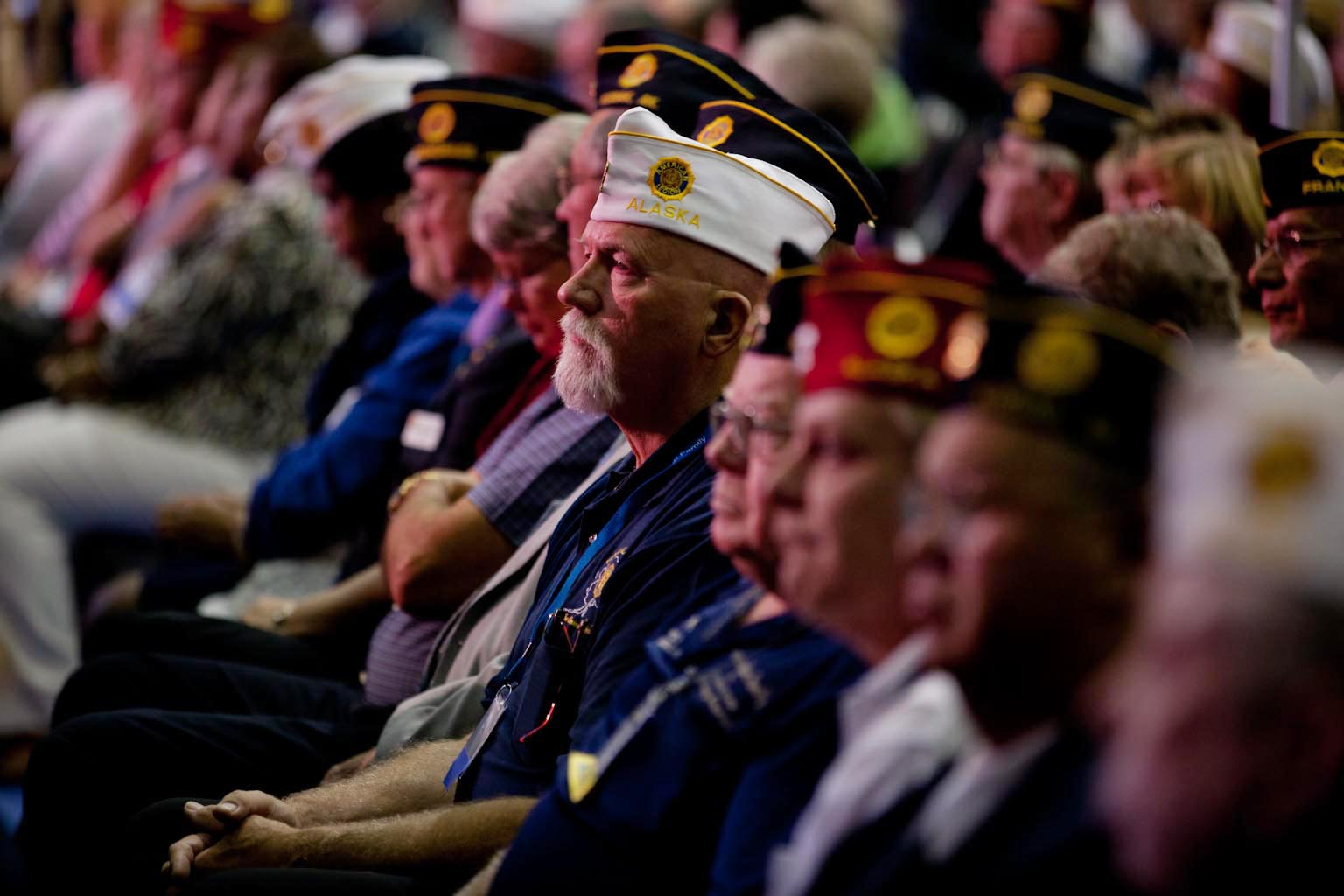 Veterans listen as President Barack Obama delivers remarks to the American Legion