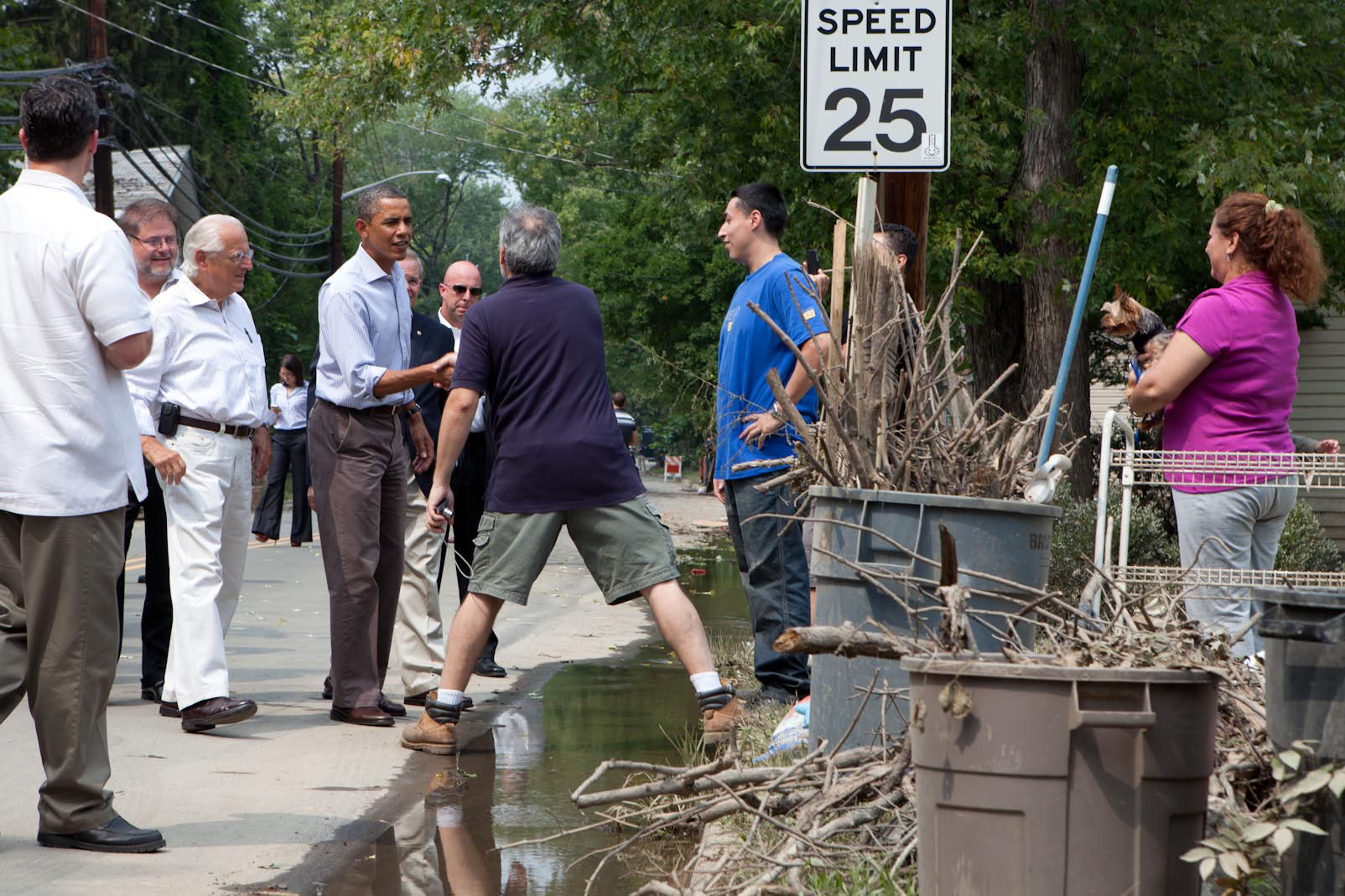 President Barack Obama talks with residents in a neighborhood hit with flooding from Hurricane Irene in Wayne, N.J.