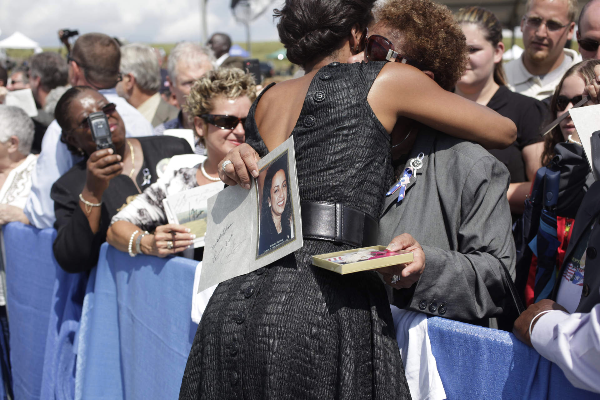 First Lady Michelle Obama hugs a woman at the 9/11 memorial in Shanksville PA