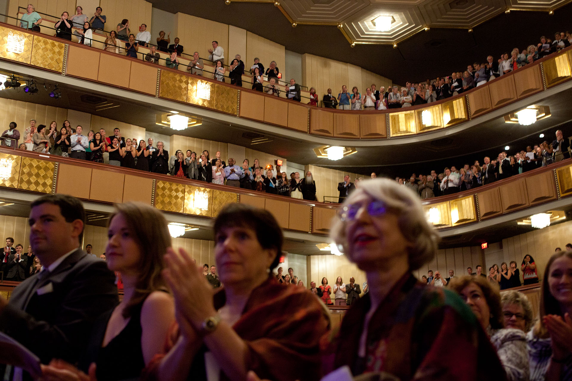 Members of the audience applaud during the Concert for Hope