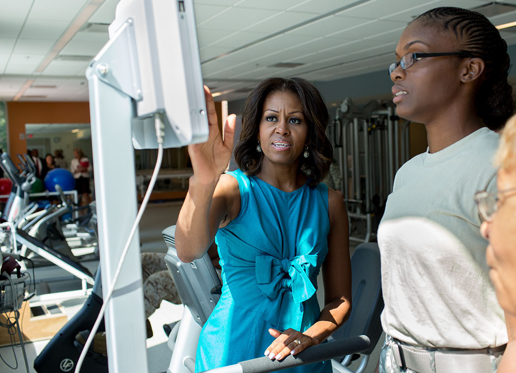 First Lady Michelle Obama joins children in an art project at the USO Warrior and Family Center