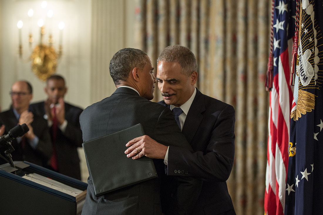 President Barack Obama hugs Attorney General Eric H. Holder Jr., after statements announcing Holder's resignation