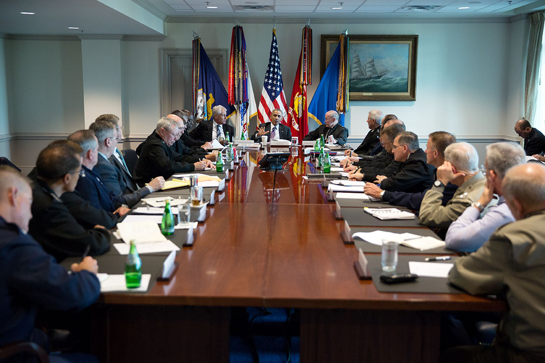 President Barack Obama meets with senior military leadership at the Pentagon in Arlington, Va., Oct. 8, 2014