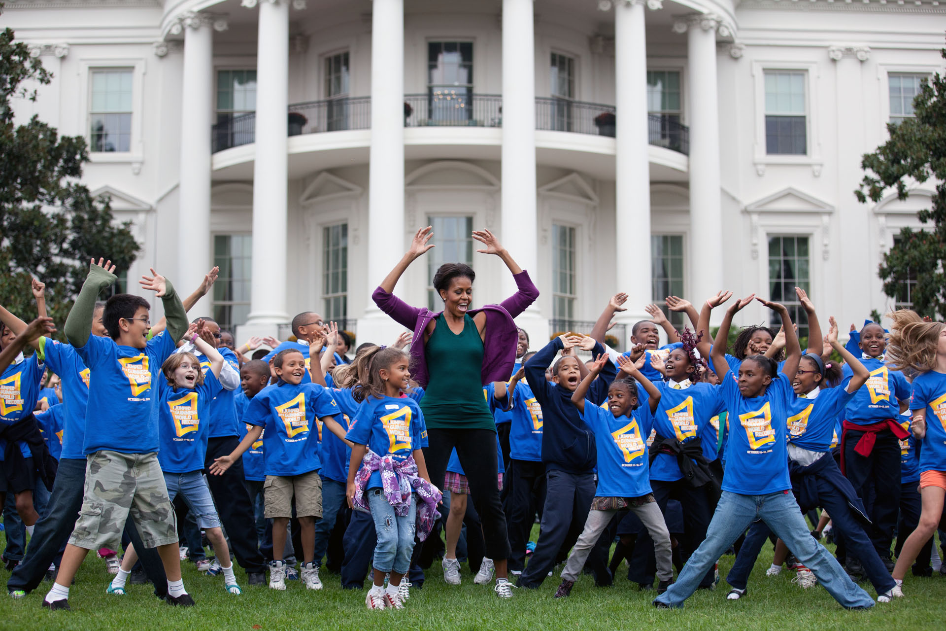 First Lady Michelle Obama leads Jumping Jacks to help break the Guinness Record
