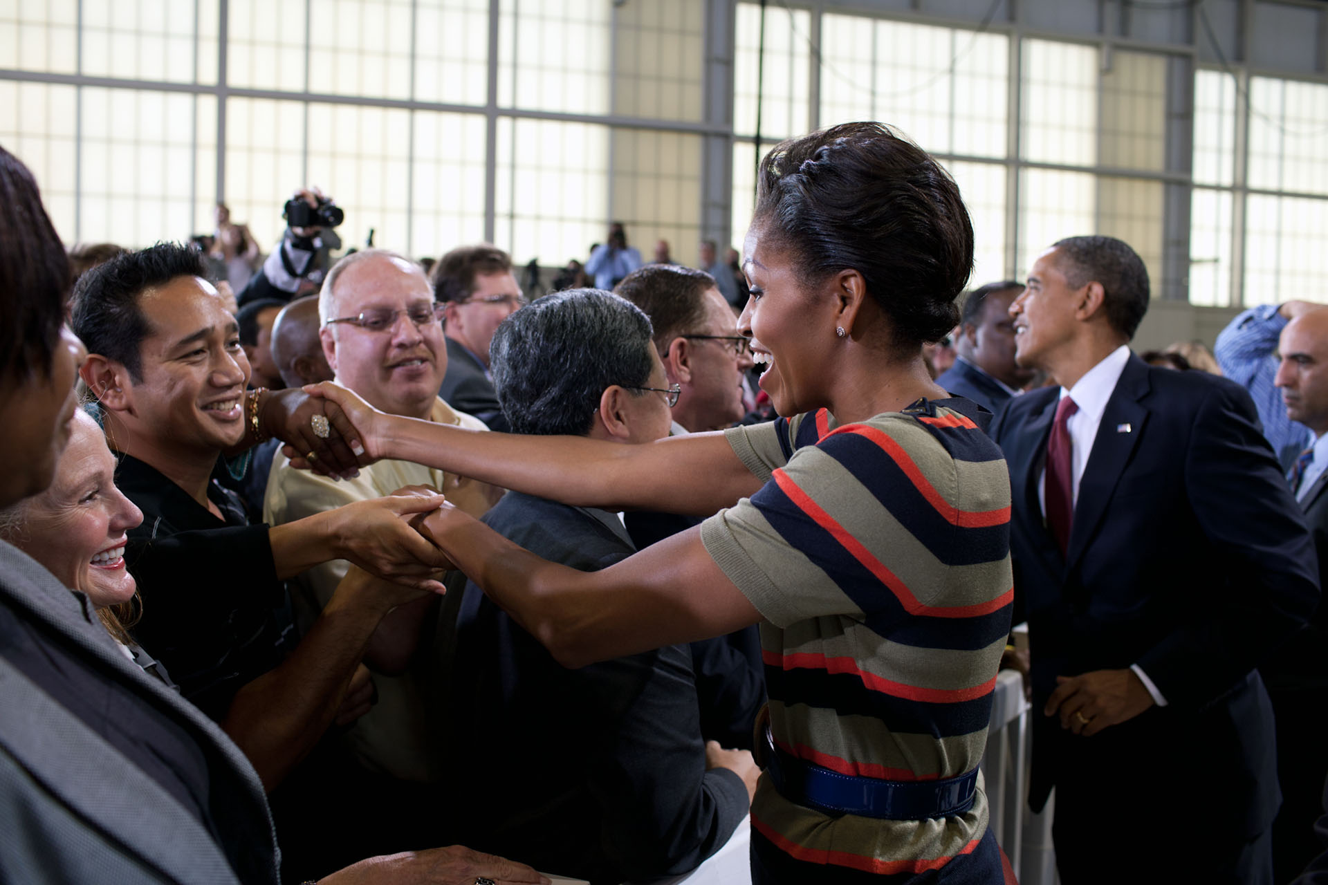 President Obama and First Lady Michelle Obama greet people at Joint Base Langley-Eustis