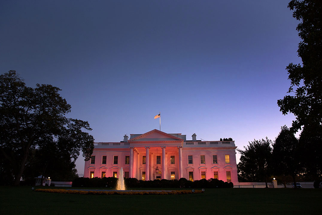 The White House is illuminated pink in honor of Breast Cancer Awareness Month