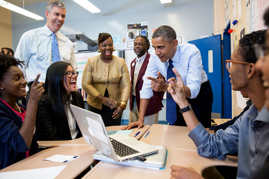 President Barack Obama and Education Secretary Arne Duncan talk with students while visiting a classroom at the Pathways in Technology Early College High School (P-TECH)